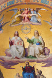 Vienna - Holy Trinity. Detail from fresco of scene from apocalypse from 19. cent. in main apse of Altlerchenfelder church Royalty Free Stock Image