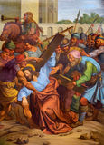Vienna - Jesus fall under cross. One part of cross way from 19. cent. in gothic church Maria am Gestade Stock Image