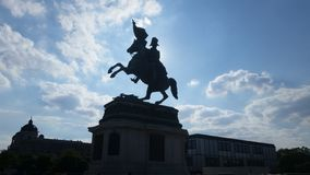 Vienna man on horse monument. Where sun is hidden behind royalty free stock photography