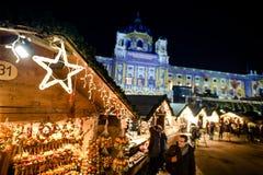 Vienna Maria Theresa Square Platz Christmas Market. VIENNA, AUSTRIA - 6 DECEMBER 2016: People visiting Maria Theresa Square Platz Christmas Market. Focus in Stock Photos