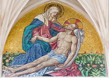 Vienna -  Mosaic of pieta from main portal of gothic church Maria am Gestade Stock Photos