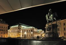 Vienna Opera House at night. The Vienna State Opera (Wiener Staatsoper) is an opera house with a history dating back to the mid 19th century. It is located in Royalty Free Stock Photos