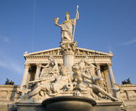 Vienna - Pallas Athena fountain and parliament Stock Image