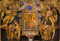 Vienna - Part of new gothic wooden polychrome side altar with Madonna in gothic church Maria am Gestade Royalty Free Stock Photography