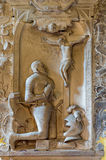 Vienna -  Prayer of knight for the corss. Relief from tomb in Michaelerkirche or st. Michael  church Royalty Free Stock Image