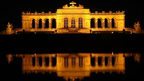 Vienna's famous Schonbrunn palace at night timelapse reflection stock video
