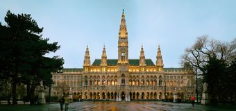 Vienna`s Town Hall Rathaus in the evening after the rain Stock Images