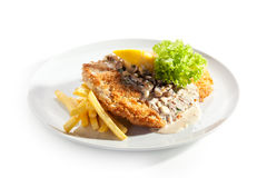 Vienna Schnitzel. Served with Mushroom Sauce and French Fries Royalty Free Stock Photography