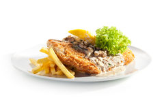 Vienna Schnitzel. Served with Mushroom Sauce and French Fries Stock Photos