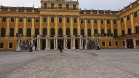 Vienna Schonbrunn Palace in Vienna. Tourists walk in front of the Palace. Schonbrunn Palace in Vienna. Tourists walk in front of the Palace 2019 stock video footage