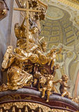 Vienna - Sculpture of Holy Trinity on the pulpit of baroque st. Peter church Stock Photography