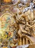 Vienna - scultura di Martyrium di St John il Nepomuk sull'altare laterale della chiesa barrocco di St Peter Fotografia Stock