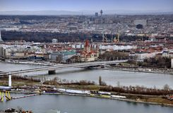 Vienna Skyline. Vienna cityscape with Danube, Reichsbrucke and St Francis of Assisi church Royalty Free Stock Image