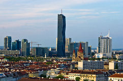 Vienna skyline at sunset, contrast between modern skycrapers and old style buildings Royalty Free Stock Images
