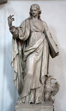 Vienna -  Statue of st. John the Evangelist in Minoriten church Stock Photo