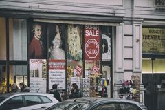 Vienna streets. Vienna, Austria: 24 January 2018: streets of Vienna at dusk with ads of souvenirs with Mozart and Klimt and sales signs stock photos