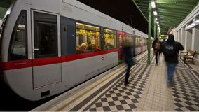 Vienna subway station night time-lapse. Time-lapse of evening rush-hour subway traffic on the line number U6 station Waehringer Strasse Volksoper. Smart city stock footage