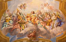 Vienna - The symbolic fresco of woman wiht the angels and music instruments in baroque church of St. Charles Borromeo stock images
