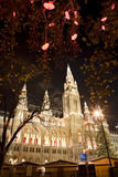 Vienna - townhall by christmas market. In the night Stock Photos