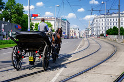 Vienna, traditional coach. VIENNA, AUSTRIA - MAY 17, 2017: traditional horse driven coach in the streets on Vienna, Austria, on may 17, 2017 Stock Photo