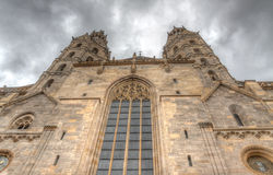 Vienna view of St. Stephen's Cathedral. Vienna view of the Cathedral of St. Stephen from the entrance up on a background of clouds HDR Royalty Free Stock Images
