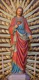 Vienne - coeur de statue de Jésus. du cent 19. dans la nef de l'église d'Altlerchenfelder photographie stock