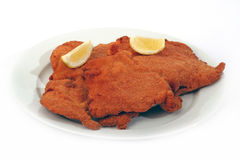 Viennese Schnitzel. On a withe background Royalty Free Stock Image