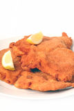 Viennese Schnitzel. On a withe background Royalty Free Stock Photo