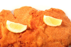 Viennese Schnitzel. On a withe background Stock Photos