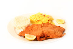 Viennese Schnitzel. Traditional  viennese Schnitzel with potato salad and rice on a withe background Stock Photography
