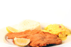 Viennese Schnitzel. Traditional  viennese Schnitzel with potato salad and rice on a withe background Royalty Free Stock Images