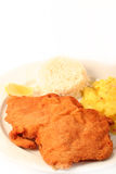 Viennese Schnitzel. Traditional  viennese Schnitzel with potato salad and rice on a withe background Royalty Free Stock Photo