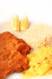 Viennese Schnitzel. Traditional  viennese Schnitzel with potato salad and rice on a withe background Stock Images