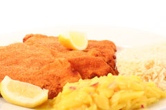 Viennese Schnitzel. Traditional  viennese Schnitzel with potato salad and rice on a withe background Royalty Free Stock Image