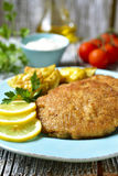 Viennese schnitzel on a blue plate. Stock Photos