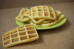 Viennese sweet waffles on a green plate. Belgian wafers with brown background. Wafers with cinnamon for breakfast Stock Images