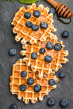Viennese waffles with honey and fresh berries blueberry and mint Stock Photo