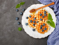Viennese waffles with honey and fresh berries blueberry and mint Stock Photos