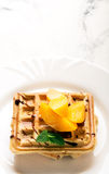Viennese waffles with peaches and chocolate Stock Image