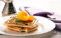 Viennese waffles with peaches and chocolate Royalty Free Stock Image