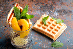 Viennese waffles with peaches and chocolate Royalty Free Stock Photography