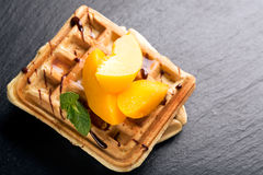 Viennese waffles with peaches and chocolate Stock Photo