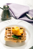 Viennese waffles with peaches and chocolate Royalty Free Stock Photo