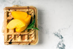 Viennese waffles with peaches and chocolate Royalty Free Stock Images