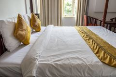 Hotel`s room and bad in Vientiane laos. Vientiane capital / Laos - 13 march, 2018: On my way to meeting, AV hotel is a choice service for room, bus ticket Royalty Free Stock Photo