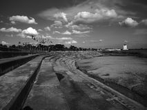 Vientiane, concrete shoreline of Mekong river. Concrete artificial riverbank of Mekong in Vientiane, Laos. Don Chan Palace in the background Royalty Free Stock Photo