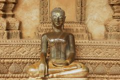 Buddha statue located at the outside wall of the Hor Phra Keo museum building in Vientiane, Laos. VIENTIANE, LAOS - APRIL 23, 2012: Buddha statue located at the Stock Photography