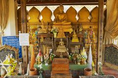 Buddha statues and altar in a small chapel next to the Pha That Luang stupa in Vientiane, Laos. stock photo