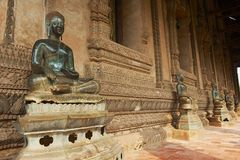 Buddha statues located at the outside wall of the Hor Phra Keo museum building in Vientiane, Laos. VIENTIANE, LAOS - APRIL 23, 2012: Buddha statues located at Royalty Free Stock Image