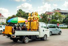 Vientiane, Laos - November 20, 2015: Buddha statues in traffic Stock Images